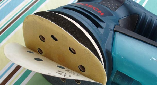 Bosch sander with velcro hook and loop sandpaper attachment
