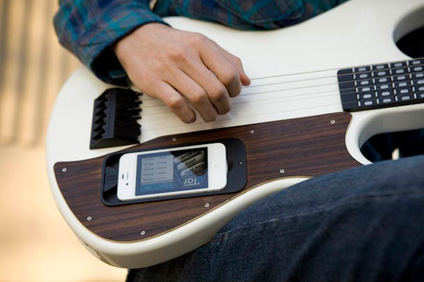 An iPhone-powered teaching guitar